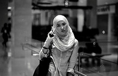 spotlight ii (i.am.syahir) Tags: old blackandwhite bw slr art girl smile night analog 50mm still asia natural kodak hijab malaysia kualalumpur analogue manual potrait kl manualfocus lumpur potraiture konicaminolta rokkor rokkor50mmf14 kodakblackandwhite400cn