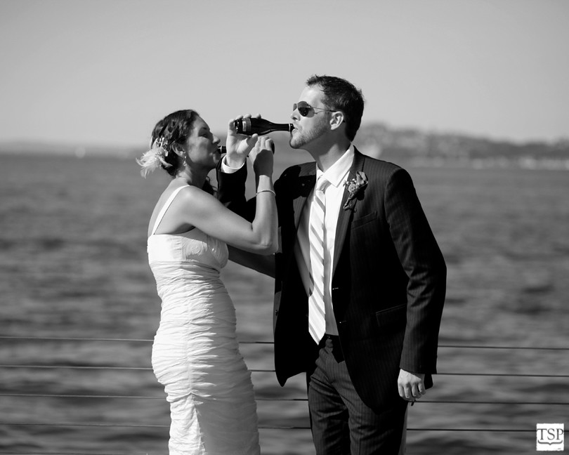 Bride and Groom Drink Arm in Arm