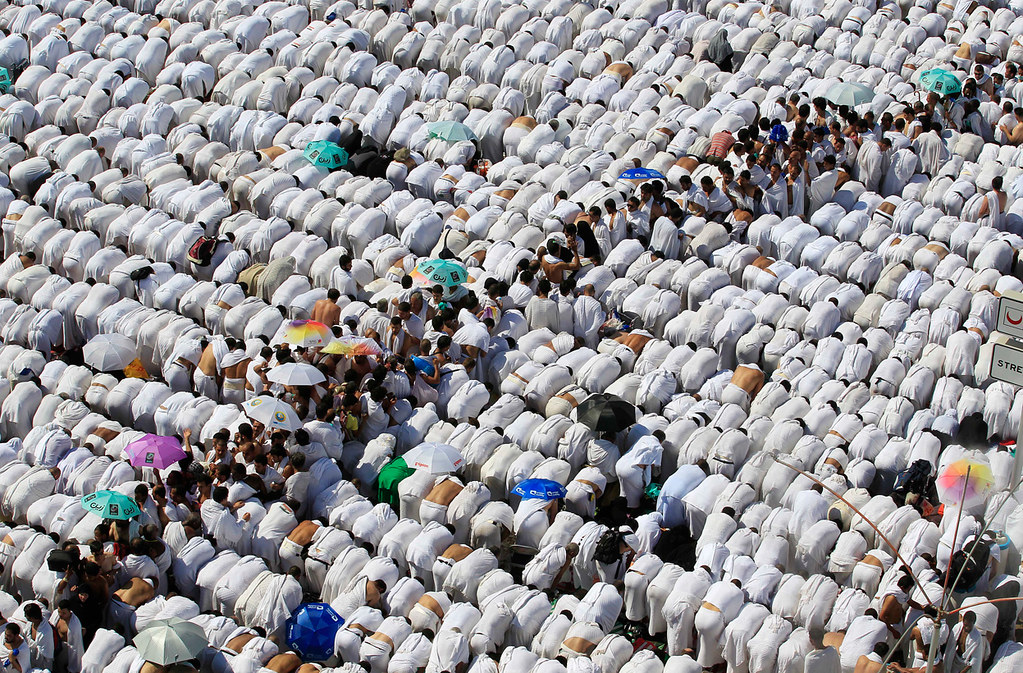 Muslim pilgrim pray outside Namira mosque in Arafat near Mecca, Saudi Arabia,