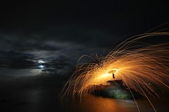 Fire Side of the Moon (pominoz) Tags: moon man silhouette night clouds fire rocks great nsw sparks jervisbay steelwool newvision cavesbeach peregrino27newvision