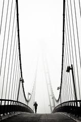 fog IV (thombe77) Tags: bridge people bw white black fog canon germany deutschland eos 50mm nebel magdeburg sw runner brücke schwarz läufer weis 400d