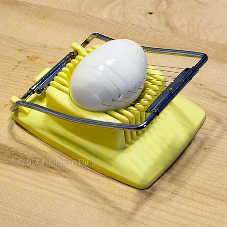 egg slicer slicing hard-boiled egg parallel to equator