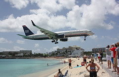 Maho Beach (Mark Chandler Photography) Tags: ocean sea vacation beach plane canon airport aviation jet stmartin landing caribbean boeing stmarteen 757 xsi boeing757 mahobeach 450d markchandler