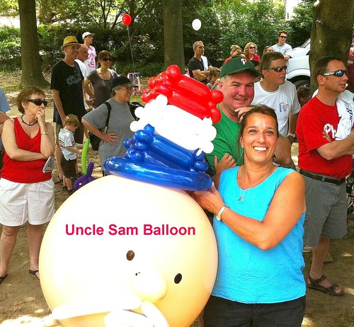 Hannah wins Uncle Sam Balloon at Bocce Club July 4th  Celebration at Water Tower