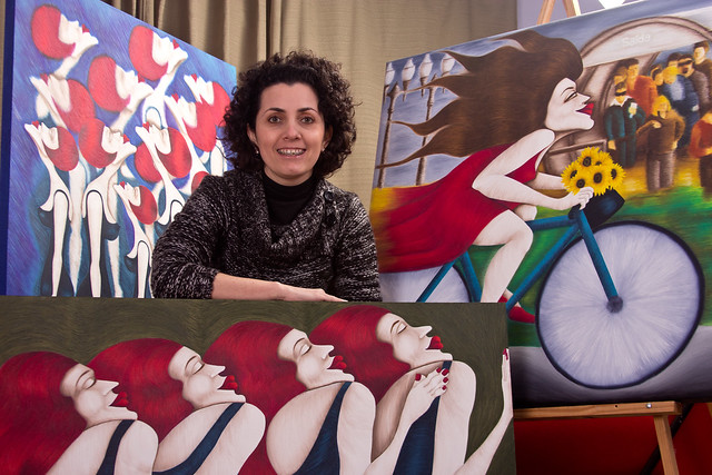 Katia and three paintings