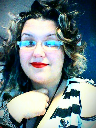 Me, with bright red lipstick and a lot of high contrast