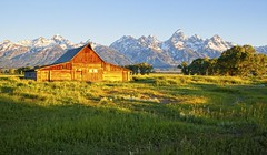 morning light at Thomas Moulton barn on Mormon Row (Marvin Bredel) Tags: mountains barn rural sunrise landscape morninglight photo national wyoming teton cheap jacksonhole grandtetonnationalpark mormonrow parknational dirtcheapphototours bredel marvinbredel dcptjuly2011 thomasmoulton southmoultonbarntetonsgrand parkmorningdirt tourmarvin908marvin
