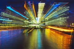 The City, Boom or Bust? (adrians_art) Tags: city longexposure abstract london water lines reflections patterns kaleidoscope nighttime docklands riverthames citibank zooming isleofdogs barclaysbank