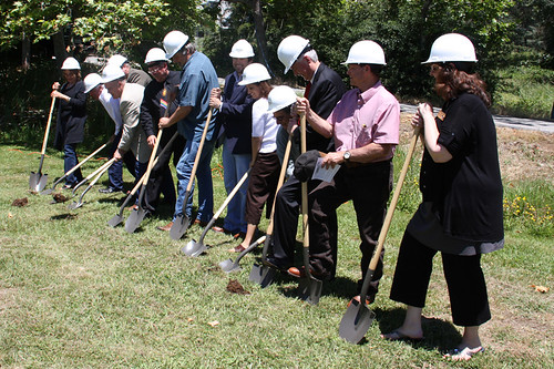 Fundamental project partners and community supporters participate in ceremonial groundbreaking.