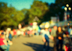 State fair bokeh. Again. (Irene2005) Tags: blur 35mm crossprocessed october bokeh crowd raleigh outoffocus lateafternoon longshadows ncstatefair f20 primelens hbw nikond90 texturebyjessicadrossin