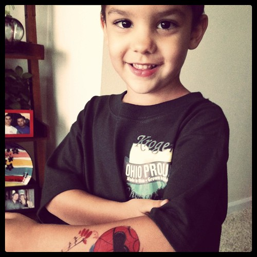 Showing off his spiderman tattoo :)