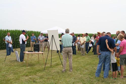 Tour participants listen to experts about the test plot expectations.