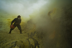 sulfur miner on ijen crater (yunaidi joepoet) Tags: morning lake reflection misty fog stone night sunrise indonesia landscape volcano mirror photo big mine foto acid hill east mount crater labour worker gunung sulfur siluet miner biggest carries surabaya malam alam asap tambang silhoute eastjava kekayaan ijen minner kawah banyuwangi perjalanan photostock keranjang bondowoso sulphure belerang