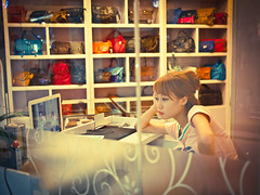 Another Boring Day (imsuri) Tags: china light red portrait people colors girl beautiful beauty television shop lumix tv alone g watch chinese streetlife screen boring panasonic chinadigitaltimes bags 20mm 365 sales owner nanning 274 day274 f17 2011 gf1  project365 streetsnap  microfourthirds