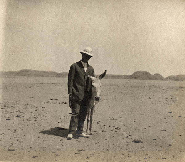 David Randall-MacIver with a donkey in Nubia, Egypt c. 1907. Penn Museum image #175378