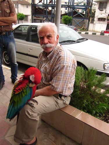 A man, his moustache, and his parrot. Epic.