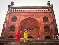 Entrance gate to Jama Masjid. New Delhi, India (NeSlaB .) Tags: world poverty door city woman india building colors canon religious temple photo women asia dress muslim faith religion folklore mosque clothes celebration holy historical rite hindi pilgrim rites developingcountries reportage pilgrims jamamasjid   thirld   neslab