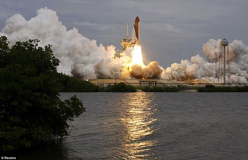 Let's light her up one last time! Atlantis overcomes a shaky launch to become the final Nasa shuttle to blast into space  3