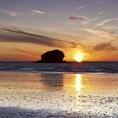 Gull Rock [Explore #174, July 8, 2011] (Martin Mattocks (mjm383)) Tags: sunset shadow seascape reflection silhouette clouds canon golden cornwall pebbles explore gullrock singhray mjm383 portreathe martinmattocksphotography