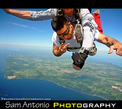 Getting High over Door County, Wisconsin (Sam Antonio Photography) Tags: blue sky wisconsin skydiving scenic lakemichigan greenbay skydive 4thofjuly dropzone doorcounty parachute freefall tandemjump airbourne sturgeonbay tandemskydive freefalling adventurephotography doorcountypeninsula samantonio samantoniophotographycom skydivedoorcounty stunningphotogpin
