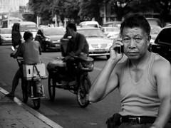 the call (jobarracuda) Tags: china bicycle chinese cellphone cellularphone fz50 dongguan panasoniclumix chinesebike jobarracuda jojopensica pensica oliverpensica dongguanstreet