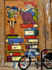 Another Oak Park viaduct mural, another bike (yooperann) Tags: park railroad people children reading illinois oak mural library books viaduct chicagoist