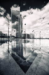 Tour First (Philipp Klinger Photography) Tags: light shadow sky bw sculpture white house black paris france reflection building tower water glass lines architecture clouds contrast skyscraper reflections dark la blackwhite nikon fran