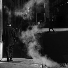the three. (Vitaliy P.) Tags: street new york city nyc winter light people white man black cold men monochrome walking square lens grate photography three nikon downtown shadows manhattan candid smoke january steam explore sidewalk crop ear gothamist kit earmuffs jackets muffs 2011 explored d80 18135mm vitaliyp