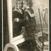 Portrait of a young boy looking in a mirror by A. M. Rothschild & Co. (c.1900)