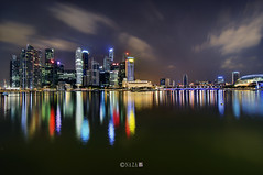 The Night That The Lights Never Went Out | Part 6 | Singapore (naza.carraro) Tags: show park city travel blue light red party vacation cloud holiday motion color green tourism water yellow festival museum architecture marina river geotagged bay hall sand nikon singapore asia cyan quay tokina hour malaysia esplanade cbd fullerton merlion temasek singapura mbs raffles sungai ntuc kallang maybank d90 naza artscience naza1715 nazarudin