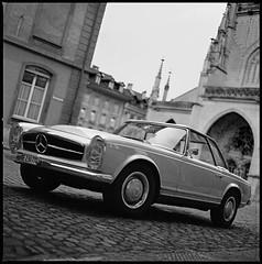 Mercedes II (Stefan G.) Tags: blackandwhite bw classic film monochrome car zeiss mediumformat mercedes benz switzerland hasselblad analogue berne 500cm mnsterplatz planar80mm28t