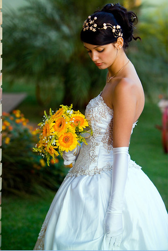 Bride in a white wedding gown eith a yellow bouquet