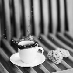 Splash! (eriwst) Tags: bw motion 6x6 cup tasse coffee café square drops cookie dof bokeh experiment kaffee dash bewegung espresso splash tropfen koffein kaffeetasse caffein 85mmf18 spritzer kaffeepause ericwüstenhagen cookiesplash