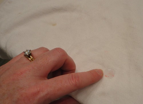 Rub Stain Remover in Gently with Finger