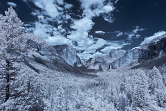 Tunnel View of Yosemite Valley in Infrared (x-ray tech) Tags: california road park blue red sky cliff cloud mountain snow color tree beautiful field rock speed america forest photoshop canon ir eos rebel weird waterfall interestingness spring amazing nice interesting mod highway focus different view angle spectrum mask god unique tripod wide may large sigma tunnel sharp explore national adobe swap level yosemite shutter granite halfdome infrared modified converted unusual capture elcapitan ultra depth 1224mm bizarre breathtaking bless 41 unsharp bridalveilfall focal wawona xti cs5