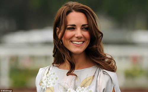 Kate Middleton keeps it simple in a fresh and floral dress as she and Prince William mingle with celebrities at charity polo match  3