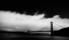 Mystic Gate (Rob Shenk) Tags: ocean sanfrancisco california bridge sky blackandwhite bw water silhouette fog clouds bay goldengate nik