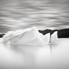 Iceberg (Maria Stromvik) Tags: longexposure shadow sky mountain lake seascape cold reflection ice nature clouds landscape iceland glacier iceberg vulcano jkulsrln waterscape ndfilter hoyand8 bwnd110
