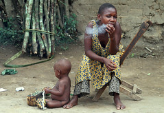 Pygmy Mother Smoking Weed (cowyeow) Tags: poverty africa people baby playing mom interesting weed child play african mommy poor young mother culture tribal smoking pot drugs drug hungry bud congo uganda tribe marijuana ethnic joint maternal indigenous hemp pygmy malnutrition pygmies youngmother drugabuse smokingpot semliki semlikinationalpark