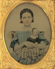 "1857 Ambrotype of ""Girl Holding Her Izannah Walker Doll"" (Mirror Image Gallery) Tags: ambrotype antiquedolls kidswithtoys victoriandolls tintedambrotypes 1857photography"
