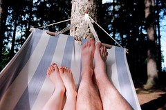 two of these feet are mine. (toulouse goose) Tags: summer film feet 35mm canon rebel backyard toes kodak waterloo hammock wilmot baden ti spruce ef 300v ektar100