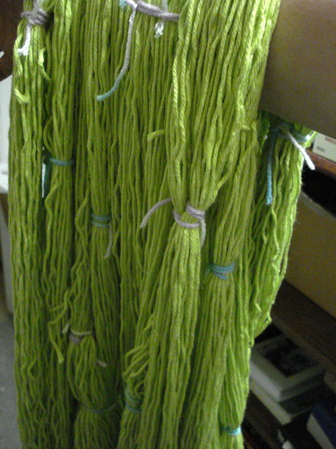 Secure tied hanks skeins of yarn yellow green