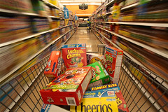 Cereal Induced Sugar High (AJ Brustein) Tags: blue atlanta red motion blur green colors yellow breakfast canon ga georgia lens aj store high angle post box juice trix wide cereal shoppingcart supermarket sugar aisle motionblur drinks pile grocery cheerios kelloggs daze luckycharms kroger fruitloops fruitypebbles capncrunch honeybunchesofoats generalmills brustein wholegrain familysize cinnamontoastcrunch 50d