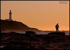 132 Fishing at Sunrise (Chrisjam2009) Tags: lighthouse sunrise fishing fisherman rocks waves chrisjames norahhead soldiersbeach canon60d sunrisesoldiersbeach