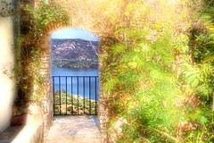 Lake Through The Arch (Light+Shade [spcandler.zenfolio.com]) Tags: plants lake castle canon geotagged eos spain europe arch view andalucia espana andalusia bushes hdr highdynamicrange lightshade 2011 castellardelafrontera tonemapped tonemapping hdrphotography 450d canoneos450d hdrphotographer stephencandler stephencandlerphotography spcandlerzenfoliocom