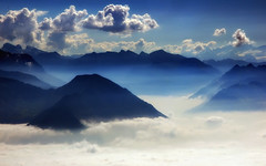 Symphony in Blue (ceca67) Tags: blue sky mountain alps art nature colors fog clouds landscape switzerland photo nikon day mood swiss fineart mount svetlana panorame 2011 d90 ceca fleursetpaysages