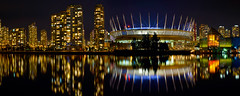 Vancouver BC Skyline with BC Place Stadium Night Panorama (David Gn Photography) Tags: city travel light panorama canada reflection sports water skyline night vancouver buildings evening living concert downtown cityscape bc waterfront britishcolumbia performance property scene seawall arena falsecreek condos venue condominiums bcplacestadium canoneos7d sigma2470mmf28ifexdghsm sigma50th longexposurerawstitchedphotomerge