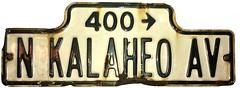A battered street sign for North Kalaheo Avenue in Kailua, Hawaii