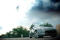 IMG_2677_00001 (SomniareProductions) Tags: blue light sky cloud sun cars silver dark automobile parking gray deck yang yin 370z