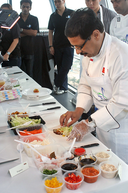 Chef Milind Sovani demonstrating canapes on board the Singapore Flyer